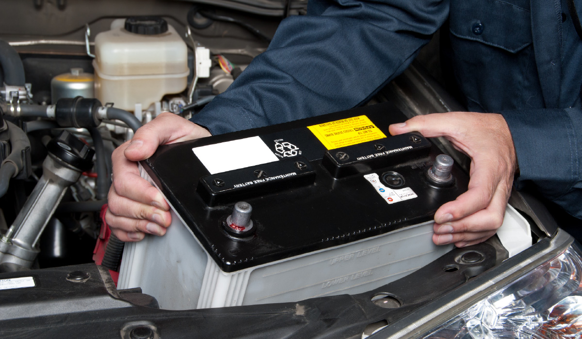 Auto-Mechanic-Replacing-Car-Battery